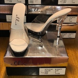 4d61a1c64993 6 inch Pointed Stiletto Mule With Wood Bottom Heel.  M 5bf8a687aa8770c744d01cee. Other Shoes you may like. Ellie M-vanity 5 inch Heel  Mule - Clear - Size 8